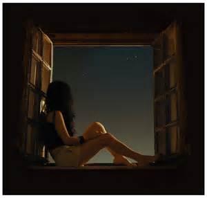 Woman at Dark Window